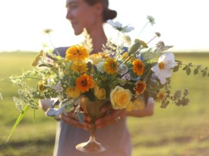 erin benzakein holding a wildflower arrangement