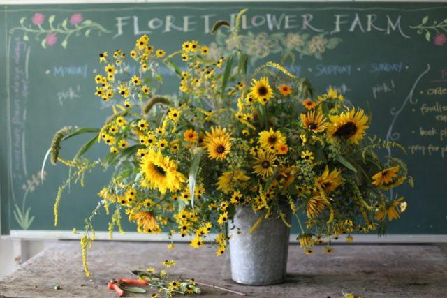 Sunflower arrangement in metal bucket