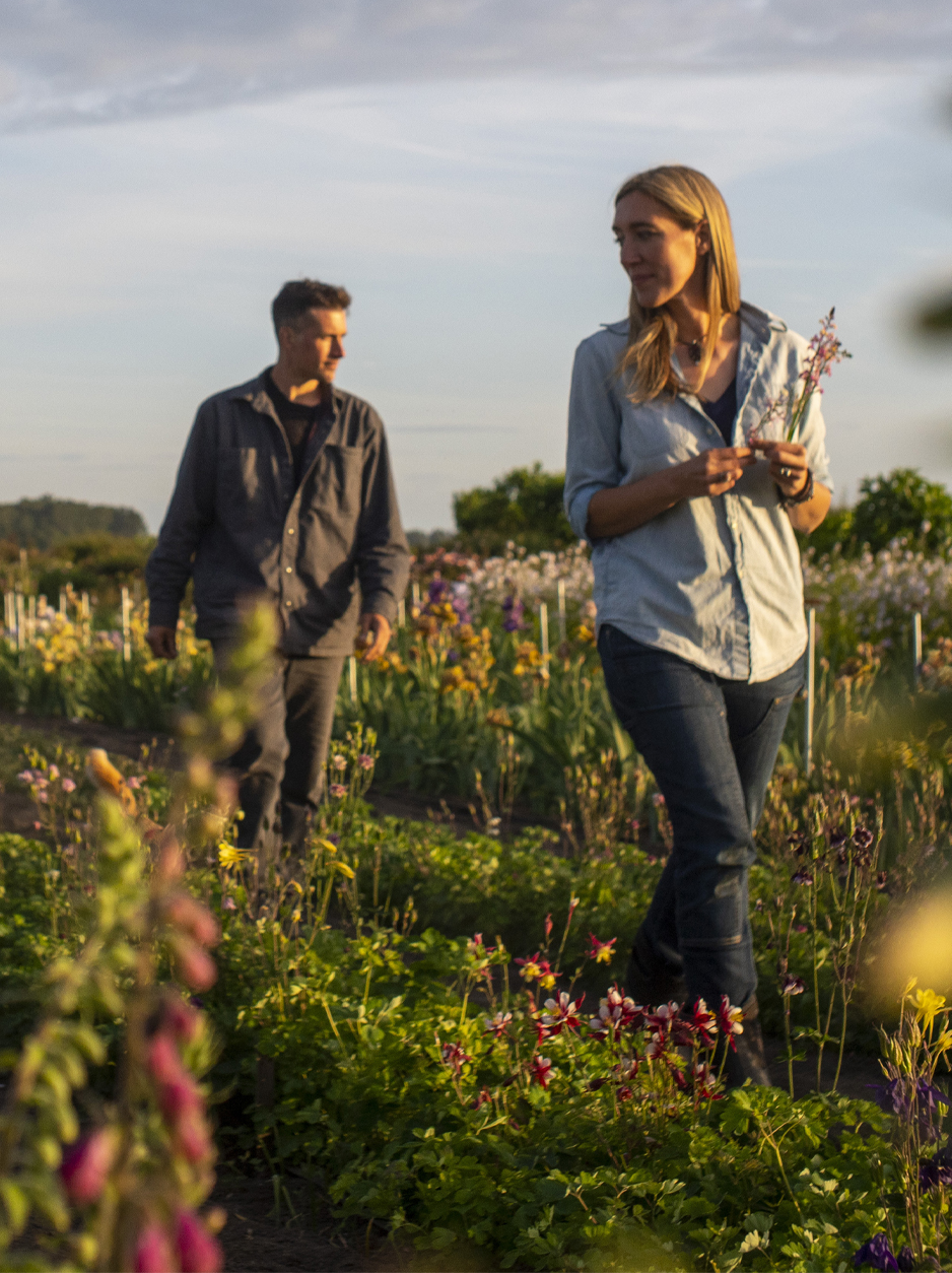 Erin and Chris Benzakein walking in the Floret field at sunset