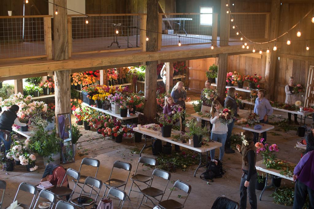 Students arranging local flowers at an on-farm Floret workshop