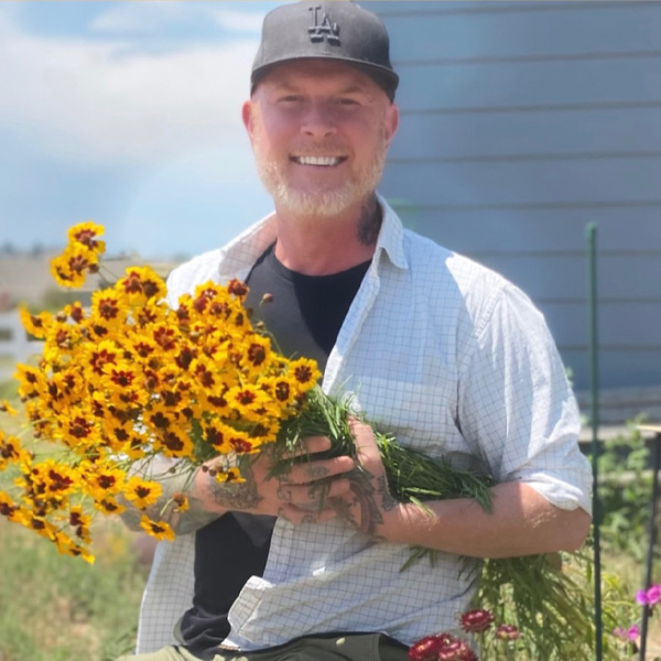 Andrew Martin with a bouquet of flowers