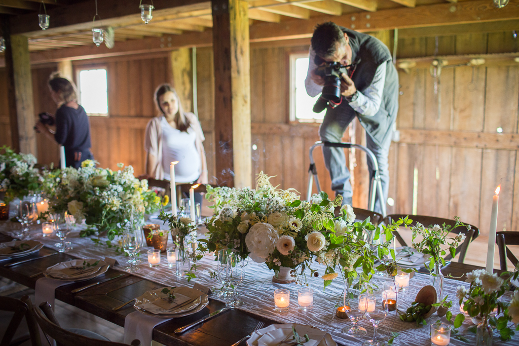 Chris Benzakein photographing a beautiful tablescape an on-farm Floret workshop