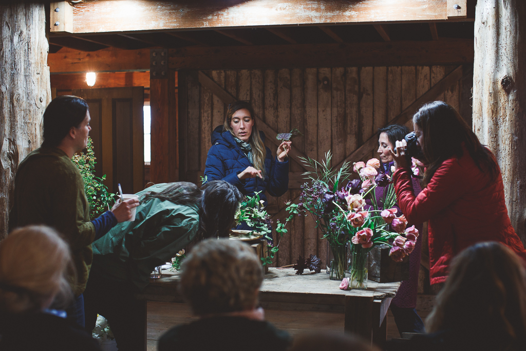 Erin Benzakein teaching a group of students at an on-farm Floret workshop